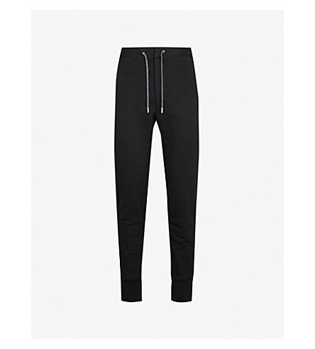 ALEXANDER MCQUEEN Skinny cotton-jersey jogging bottoms (Black