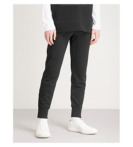 ALEXANDER MCQUEEN Skinny cotton-jersey jogging bottoms (Black