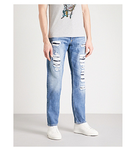 ALEXANDER MCQUEEN Distressed slim-fit tapered jeans (Blue+washed