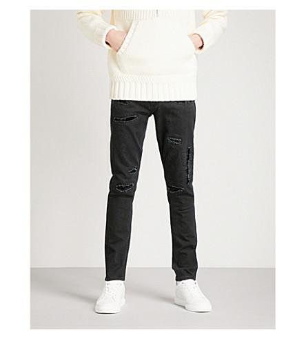 ALEXANDER MCQUEEN 憔悴瘦身紧身牛仔裤 (黑 + 水洗