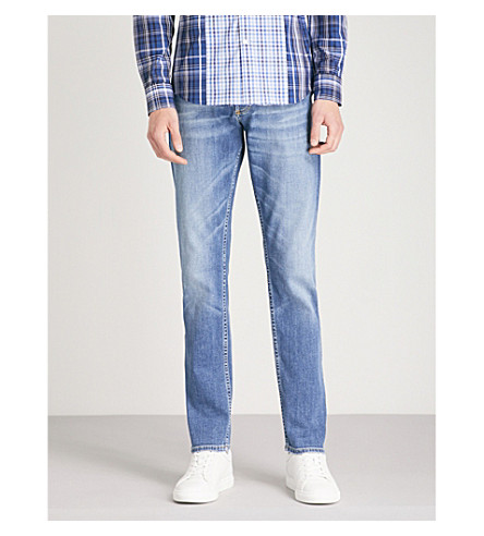 ALEXANDER MCQUEEN Faded slim-fit tapered stretch-denim jeans (Blue