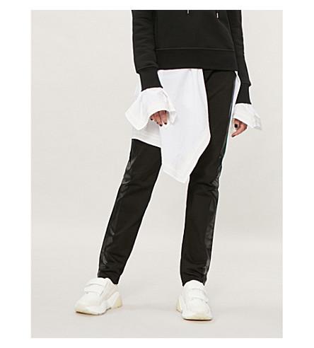 ALEXANDER MCQUEEN Metallic side-stripe mid-rise skinny jeans (Black black
