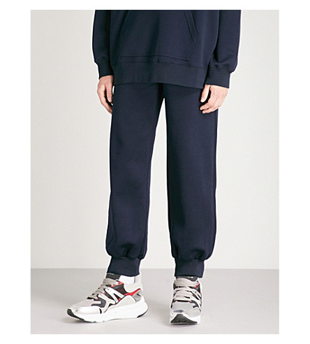 ALEXANDER MCQUEEN Crest logo-patch jersey jogging bottoms (Navy