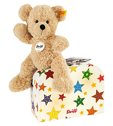STEIFF Fynn teddy bear with suitcase 28cm