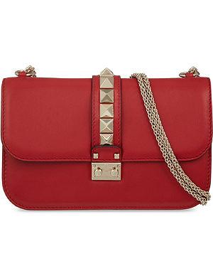 VALENTINO Lock stud leather clutch