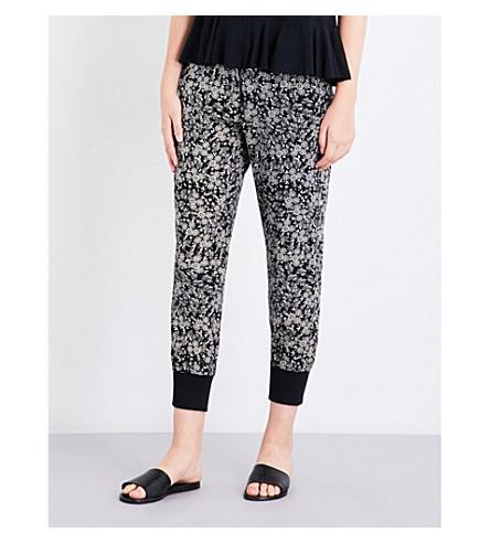 THE KOOPLES Waterlily-print skinny silk-crepe jogging bottoms (Bla06