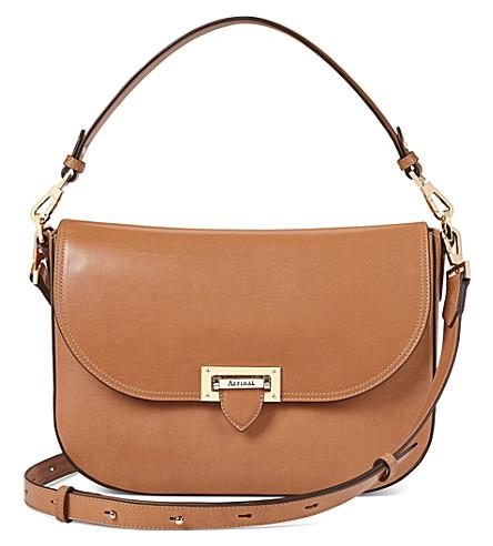 Slouchy leather saddle bag