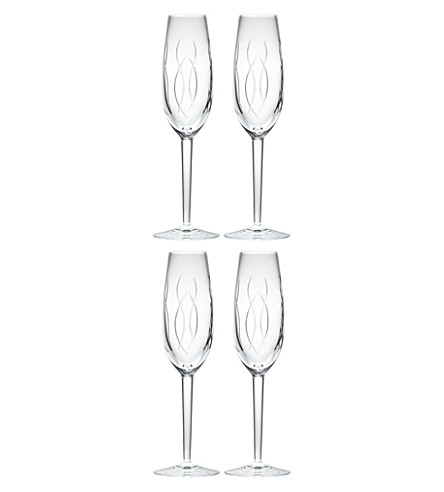 JOHN ROCHA @ WATERFORD Set of four crystal champagne flutes