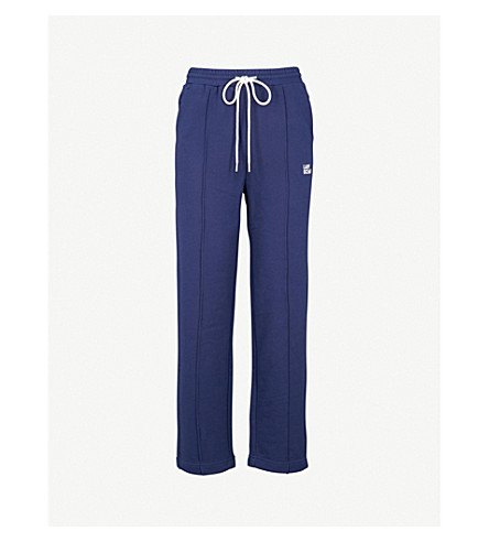MO&CO. Embroidered jersey jogging bottoms (Blue