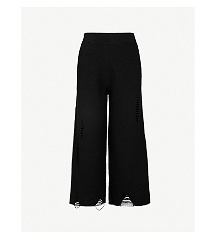 MO&CO. Distressed wide-leg wool trousers (Black