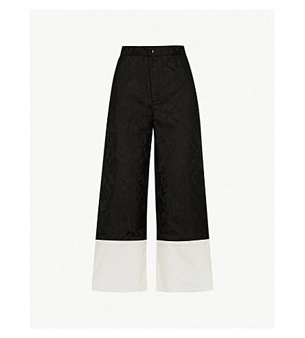 MO&CO. Wide-leg turn-up jacquard trousers (Black