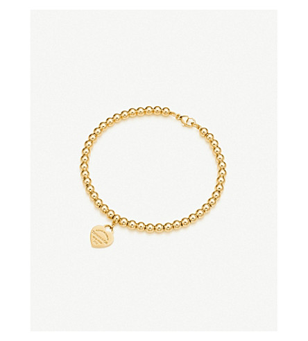 TIFFANY & CO Return to Tiffany™ mini heart tag in 18k gold on a bead bracelet