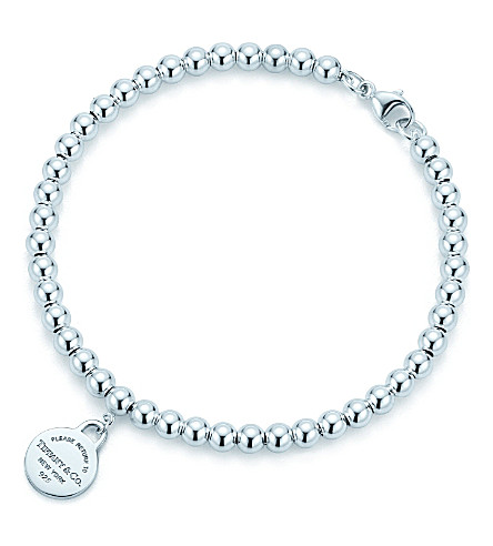 TIFFANY & CO Return to Tiffany round tag in sterling silver on a bead bracelet