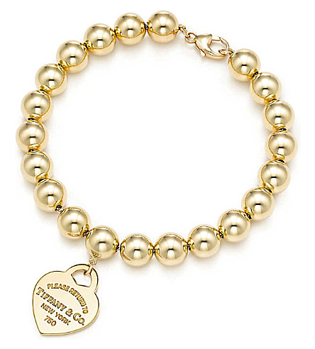 TIFFANY & CO Return to Tiffany small heart tag in 18k gold on a bead bracelet