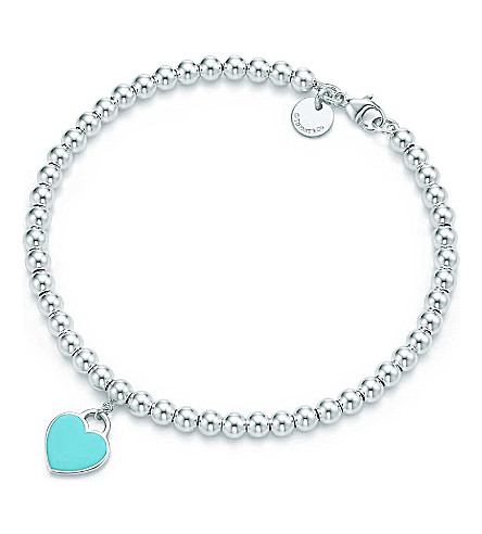 TIFFANY & CO Return to Tiffany mini heart tag in sterling silver on a bead bracelet