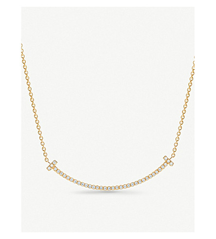 TIFFANY & CO Tiffany T smile pendant in 18k gold with diamonds, mini