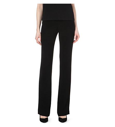 MAJE Fameux bootcut trousers (Black