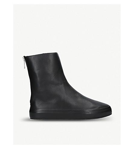 UNONOVANTACINQUE Sauvage leather ankle boots (Black