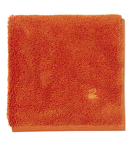 YVES DELORME Étoile cotton wash cloth (Orange