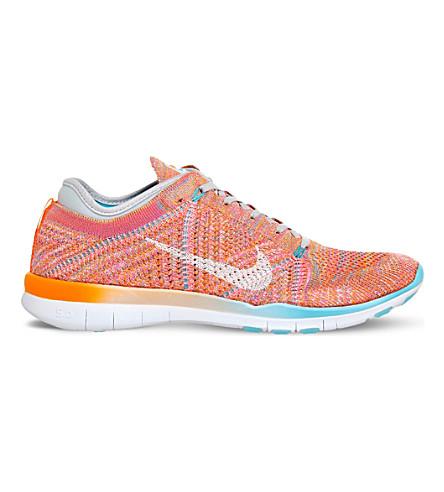 NIKE Free TR flyknit sneakers (Total orange pink