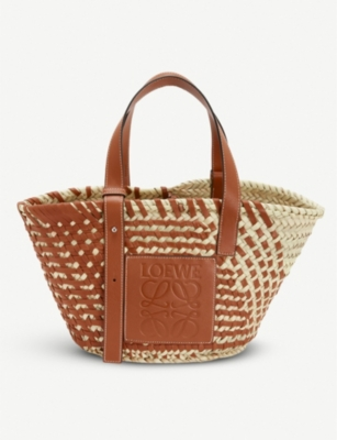 Hand-woven raffia and leather basket bag