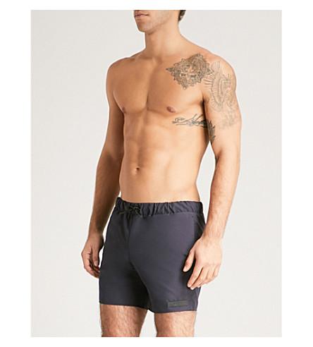 SANDRO Logo patch swim shorts (Marine