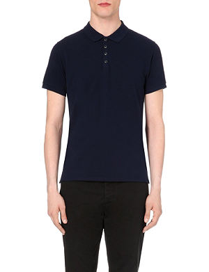 SANDRO Popper-fastened cotton-piqué polo shirt