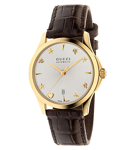 GUCCI G-Timeless yellow gold-toned and leather watch