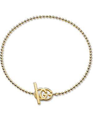 GUCCI Brand-motif 18ct yellow-gold bracelet
