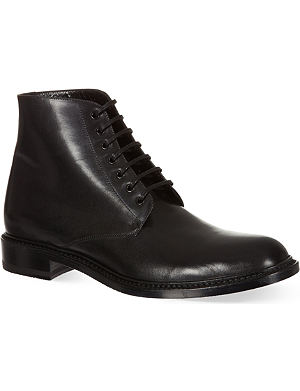 SAINT LAURENT Signature lace up boots in black leather