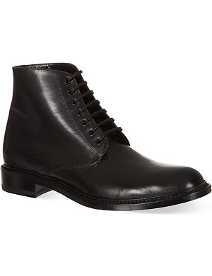 SAINT LAURENT Signature lace up boots in black leather