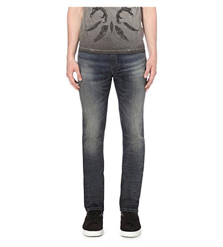 DIESEL Thavar 0674x slim-fit tapered jeans (Denim