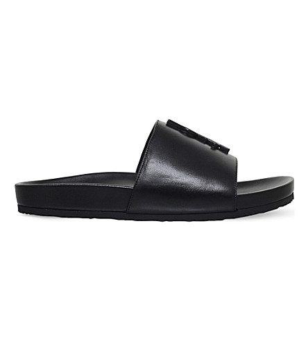 SAINT LAURENT Joan monogrammed leather pool sliders (Black