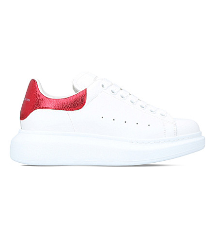 ALEXANDER MCQUEEN Oversized leather low-top trainers (White/red