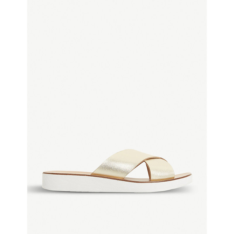 STEVE MADDEN | Trent Crossover White-Sole Sliders | Goxip
