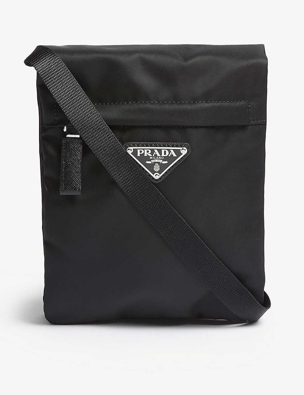 701585f43562 PRADA - Logo nylon cross-body pouch | Selfridges.com