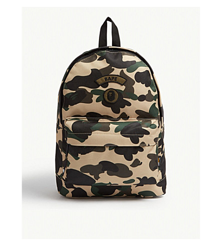 ... A BATHING APE Logo camouflage canvas backpack (Yellow. PreviousNext 6ed1386ae92bc