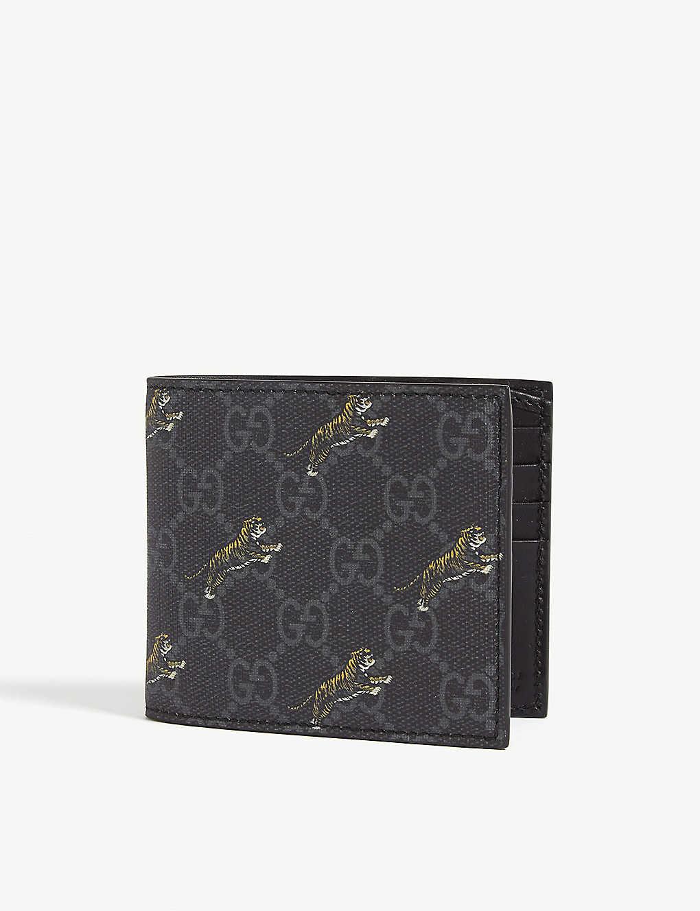 1ff9691d GUCCI - GG Supreme tigers coated canvas bifold wallet | Selfridges.com