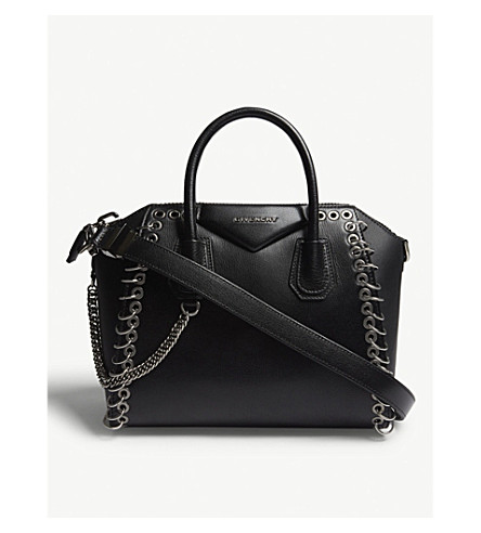 ... GIVENCHY Antigona eyelet medium leather tote (Black. PreviousNext b1141666cda5e