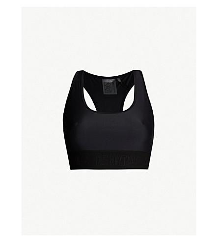 596ec5f3a6273 ... P.E NATION Somersault stretch-jersey sports bra (Black. PreviousNext
