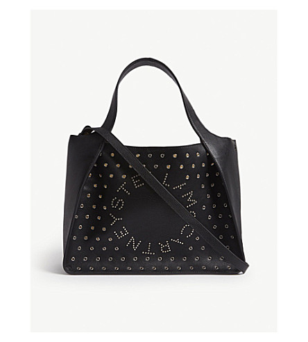 23d97d1893b3 ... STELLA MCCARTNEY Eyelet-embellished logo faux-leather tote bag (Black.  PreviousNext