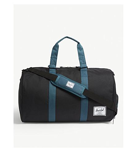f3907879b4 ... HERSCHEL SUPPLY CO Novel duffle bag (Black deep+teal. PreviousNext