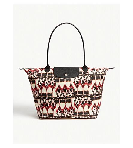 ... LONGCHAMP Le Pliage Ikat shoulder bag (Ivory. PreviousNext 1db6465d77a54