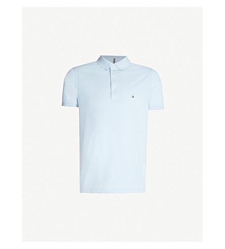 6d89c3f2acf8e ... TOMMY HILFIGER Logo-embroidered cotton-piqué polo shirt (Chambray+blue.  PreviousNext
