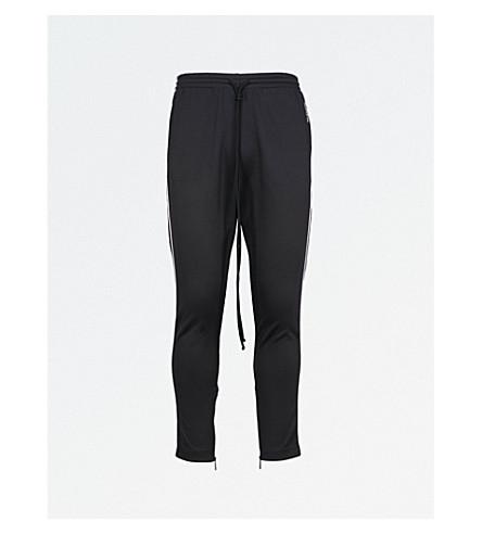 7f2523a89ee7 VALENTINO - Side-stripe jersey track pants