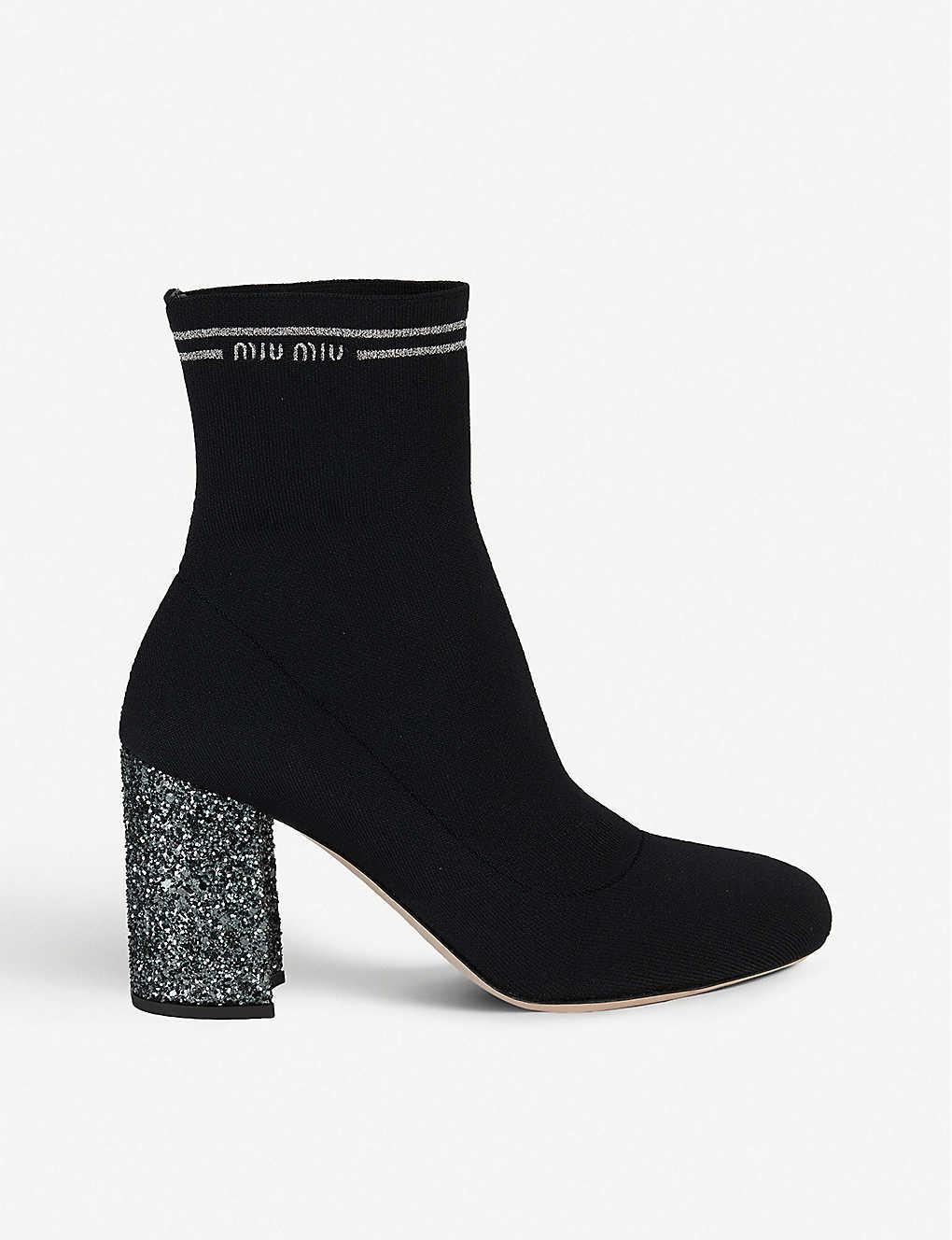 b067aee83e57 MIU MIU - Glitter-heel logo-detail ankle boots