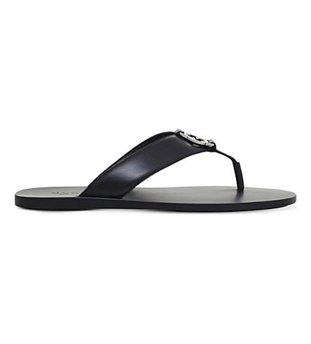 43e22c5dd956 ... GUCCI Leather logo sandals (Black. PreviousNext