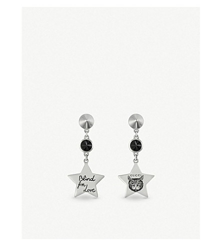ade5ed22b ... GUCCI Blind for Love star-shaped sterling silver and black spinel  earrings. PreviousNext