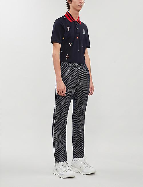 3e69dfb2d GUCCI Multi-logo embroidered cotton-piqué polo shirt