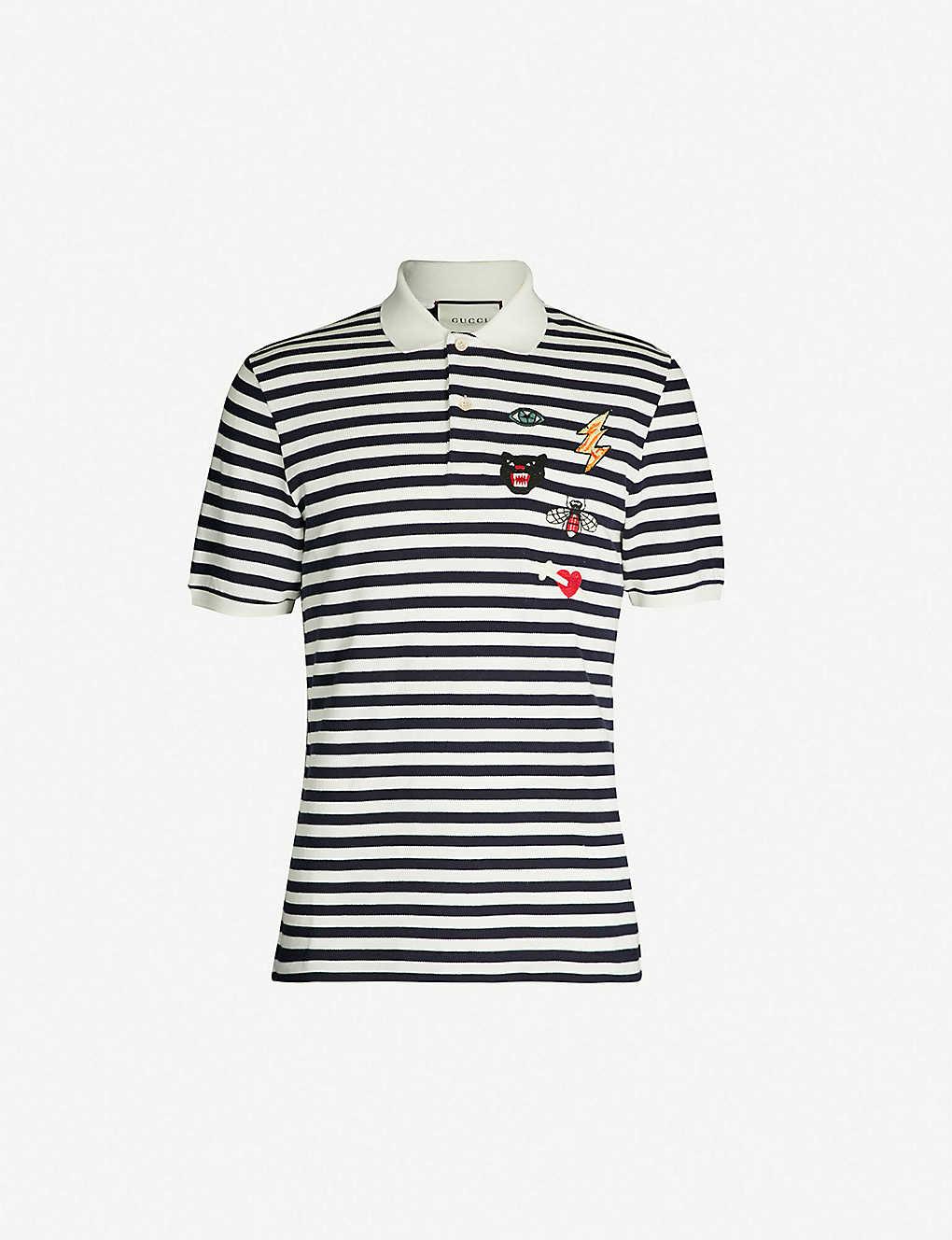 7b6904465656 GUCCI - Multi-logo embroidered cotton-piqué polo shirt   Selfridges.com